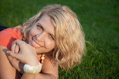 Alluring blonde woman posing in autumn park Stock Photography