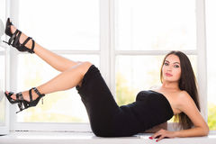 Alluring brunette in black dress Royalty Free Stock Images