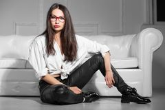 Alluring brunette in glasses royalty free stock photos