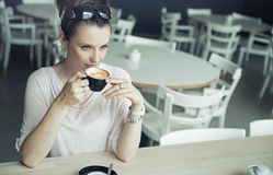 Alluring brunette lady taking a break Royalty Free Stock Images