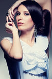 Alluring brunette over dark background. Portrait of alluring brunette over dark background Stock Photos