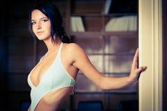 Alluring brunette wearing swimsuit Stock Photo
