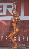 Alluring and Buff Pro Fitness Winner Royalty Free Stock Photography