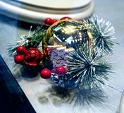 Alluring Christmas ornament decoration. Close up photo of gold ball decorated with red balls and new year tree branch stock images