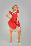 Alluring coquettish girl in spotted dress royalty free stock photography