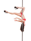 Alluring dancer on the pole Royalty Free Stock Photo