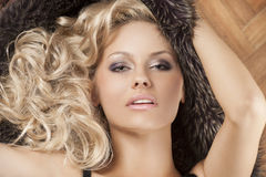 Alluring girl with blond curly hair Royalty Free Stock Images