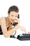Alluring girl calling at the phone Royalty Free Stock Image