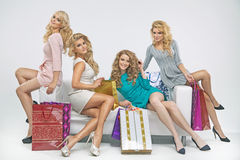Alluring ladies with plenty of shopping bags Stock Image