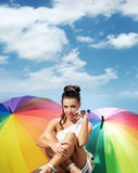 Alluring lady with a bunch of colorful umbrellas Stock Images