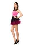 Alluring leggy brunette. Posing in short skirt. Isolated on white Royalty Free Stock Image