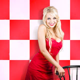 Alluring long haired blonde beauty in retro cafe Stock Photos