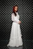 Alluring redhead lady posing in studio stock image