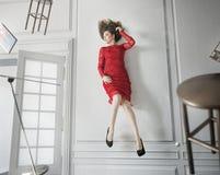 Alluring sad woman in levitating pose