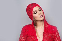 Alluring sexy woman in red knitted jacke Stock Photo