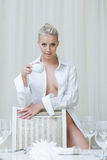 Alluring topless blonde posing looking at camera. Close-up Stock Photography