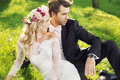 Alluring wife with her handsome groom stock image