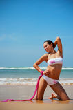 Alluring woman at the beach Stock Images
