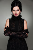 Alluring woman in black dress Stock Image
