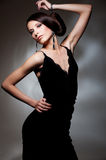 Alluring woman in black dress Stock Photography