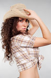 Alluring woman in cowboy hat. Posing against grey background Stock Photography