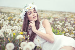 Alluring woman lying on a meadow Stock Photo