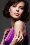 Alluring woman over dark background Stock Photos