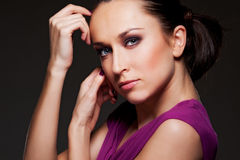 Alluring woman over dark background Stock Image