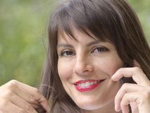 Alluring woman at phone in outdoor scene Stock Photography