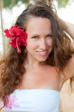 Alluring woman with red flower Royalty Free Stock Image