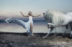 Alluring woman taming the horse Stock Photo