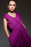 Alluring woman in violet dress Royalty Free Stock Photography