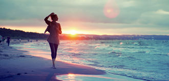 Alluring woman walking along the seaside Royalty Free Stock Photos