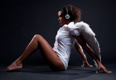 Alluring woman in white wings Royalty Free Stock Photos