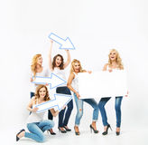 Alluring women pointing the board Royalty Free Stock Photography