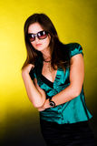 Alluring young brunette girl. Portrait of a young brunette in a green blouse Stock Photo