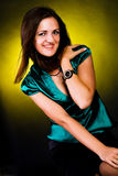 Alluring young brunette girl. Portrait of a young brunette in a green blouse Royalty Free Stock Photos