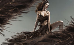 Alluring young brunette among the hair storm. Alluring young brunette woman among the hair storm Royalty Free Stock Photos