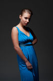 Alluring young female in blue dress Stock Images