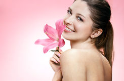 Alluring young woman with flower Royalty Free Stock Image