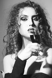 Alluring young woman with glass of wine Stock Image
