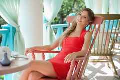 Alluring young woman sitting on the chair Royalty Free Stock Photo
