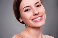 Alluring young woman smiling Stock Photos