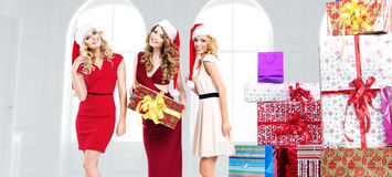 Alluring young women with gifts Stock Photo