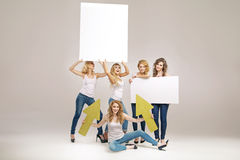 Alluring young women holding boards Stock Photography