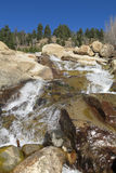 Alluvial Fan waterfall at Rocky Mountain National Park. Under blue skies royalty free stock photography