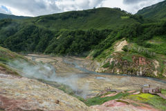 Alluvial plain at drying Geysernoye Lake in Valley of Geysers. Royalty Free Stock Photo