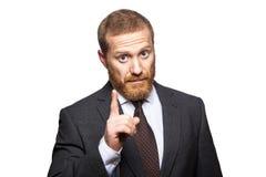 Allvarlig affärsman som visar inget tecken med hans finger mot en vit bakgrund Fotografering för Bildbyråer