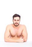 Allvarlig halva-naken man Fotografering för Bildbyråer