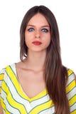 Allvarlig kvinna med blåa ögon royaltyfri foto